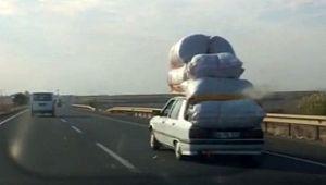 Otomobil üzerinde kamyonet yükü taşıdılar