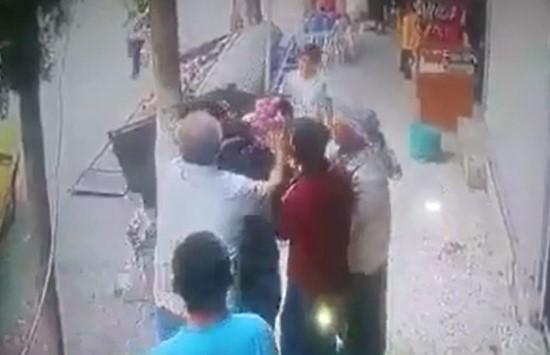 Balkondan düşen çocuğu esnaf havada yakaladı
